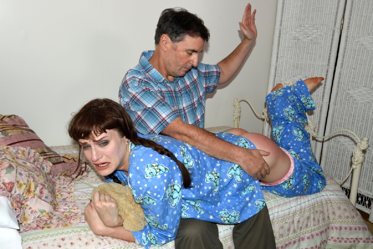 Elle knows she is in trouble and waits in her room for daddy. He comes in and there is not much talk before her spanking begins. Daddy spanks her relentlessly over her pajamas, panties, and then on the bare bottom. Her spanking ends with his thick belt to really teach his naughty daughter a lesson. It isn't until she is crying real tears that he knows she has learned her lesson.